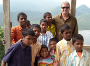 Director Geoff Hales with orphans